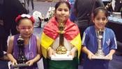 La deportista alteña Nicole Mollo (cen.) con el trofeo de campeona del Sudamericano Sub-8. Foto: FBA